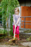 Little girl helping in a garden Royalty Free Stock Images