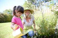 Little girl helping her mother gardening Royalty Free Stock Photos