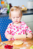 Little girl helping at kitchen Royalty Free Stock Image