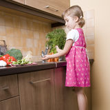 Little girl helping in kitchen Royalty Free Stock Photography