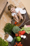 Little girl helping in kitchen Royalty Free Stock Images