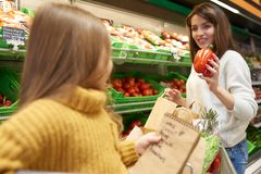 Little Girl Helping Mom with Grocery Shopping stock images