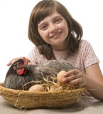 Little girl with a hen (chicken) Stock Photography