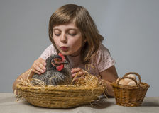 Little girl with a hen (chicken) Stock Images