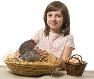 Little girl with a hen (chicken) Royalty Free Stock Images