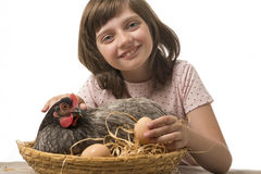 Little girl with a hen (chicken) Stock Photos