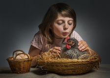 Little girl with a hen (chicken) Stock Photo