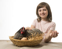 Little girl with a hen (chicken) Royalty Free Stock Image