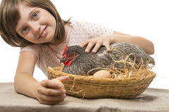 Little girl with a hen (chicken) Royalty Free Stock Photography