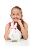Little girl with her adorable white rabbit Stock Photo