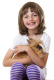 Little girl with her baby rabbit Stock Image