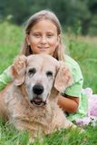 Little girl and her beloved dog Stock Images