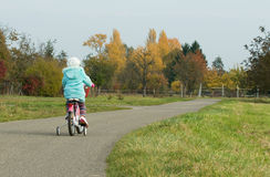 Little girl on her bicycle. German little  girl cycling.Germany Royalty Free Stock Photos