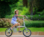 Little girl with her bicycle Stock Photography