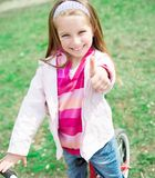 Little girl with her bicycle Royalty Free Stock Photos