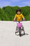 Little girl with her bicycle. Smiling Royalty Free Stock Photo