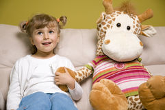 Little girl with her big friend Stock Photo