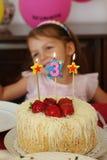 Little girl on her birthday stock photos