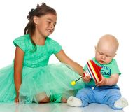 A little girl with her brother playing Royalty Free Stock Photography