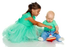 A little girl with her brother playing Royalty Free Stock Photos