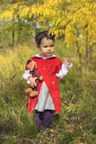 Little girl with her bunny toy in the forest Stock Images