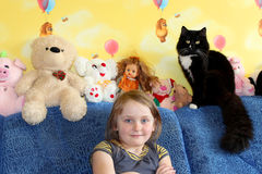 Little girl and her cat in the children's room Stock Images