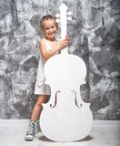 Little girl with her cello Royalty Free Stock Photo