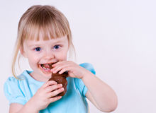 Little Girl and Her Chocolate Easter Bunny Stock Images