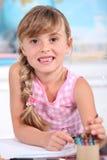 Little girl in her classroom. Stock Photos