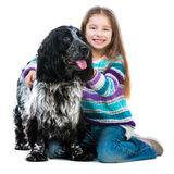Little girl with her cocker spaniel puppy dog. Happy cute little girl with her cocker spaniel puppy dog isolated on a white background stock image