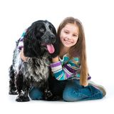 Little girl with her cocker spaniel puppy dog Royalty Free Stock Image