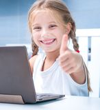 Little girl with her computer Royalty Free Stock Photography