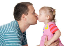 Little girl and her dad giving kiss Stock Photo