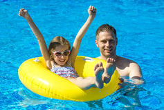 Little girl with her dad having fun. Stock Photo