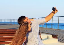 Little girl and her dad having some fun at the beach and taking a selfie Stock Photo