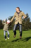 little girl with her dad jumping royalty free stock images