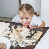 Little girl with her dirty nose helps her mother make dumplings Stock Photography