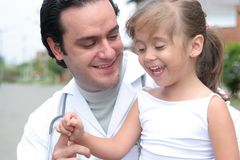 Little girl and her doctor Stock Images