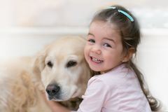 Little girl with her dog royalty free stock photo