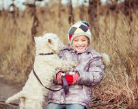 Little girl with her dog Royalty Free Stock Photography
