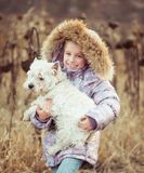 Little girl with her dog Stock Photo