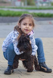 Little girl with her dog Stock Image