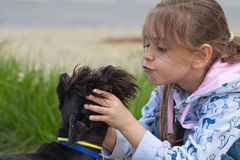 Little girl and her dog Royalty Free Stock Photo
