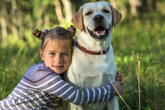 Little girl and her dog outdoors. Love. Stock Image