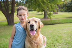 Little girl with her dog in the park Stock Images