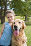 Little girl with her dog in the park Royalty Free Stock Photo