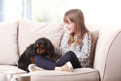 Little girl with her dog Royalty Free Stock Image