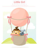 Little girl and her dog riding a hot air balloon Royalty Free Stock Photos