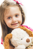 Little girl with her dog toy Royalty Free Stock Photo