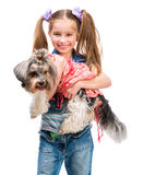 Little girl is with her dog Yorkshire Terrier Royalty Free Stock Photos